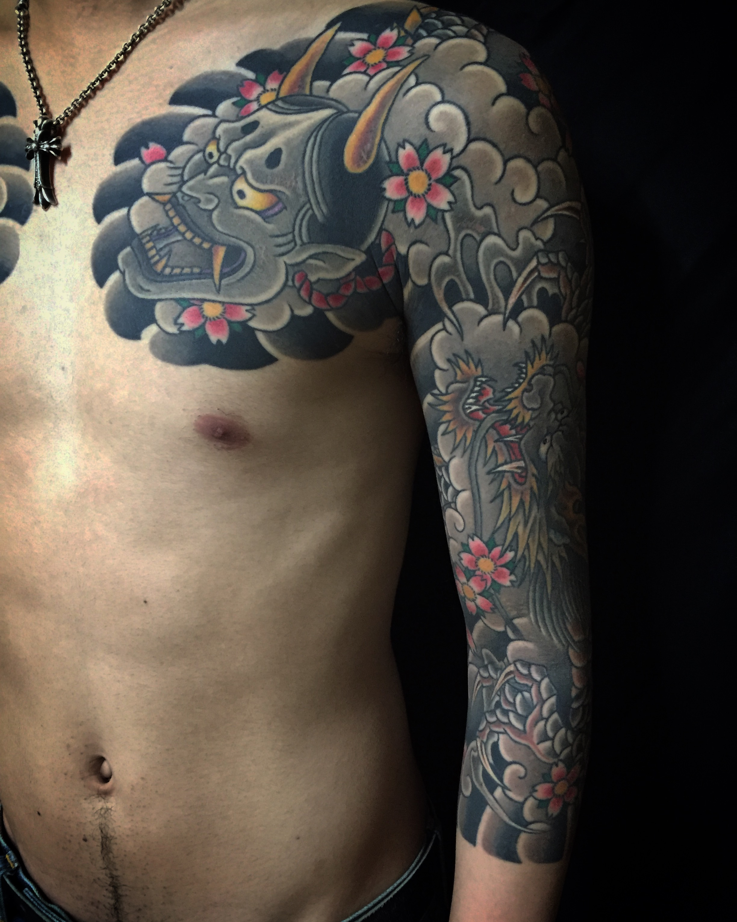 Japanese style full sleeve dragon and hannya mask tattoo